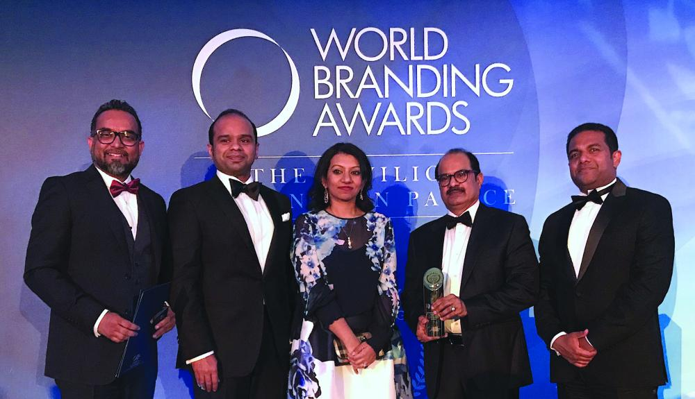 Ashraf Ali Musliam, Executive Director of LuLu Group,  along with Adeeb Ahamed, MD of LuLu Financial Group; Shafeena Yusuffali, CEO of Tablez; Mohammed Althaf, Director and V. Nandakumar, CCO of LuLu Group, with the Brand of the Year Trophy at the World Branding Award Ceremony at the Kensington Palace in London.