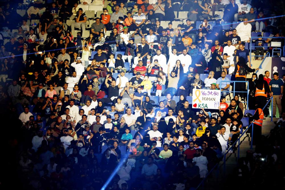 Fans watch the WWE Crown Jewel show at King Saud University Stadium in Riyadh Friday. — Reuters