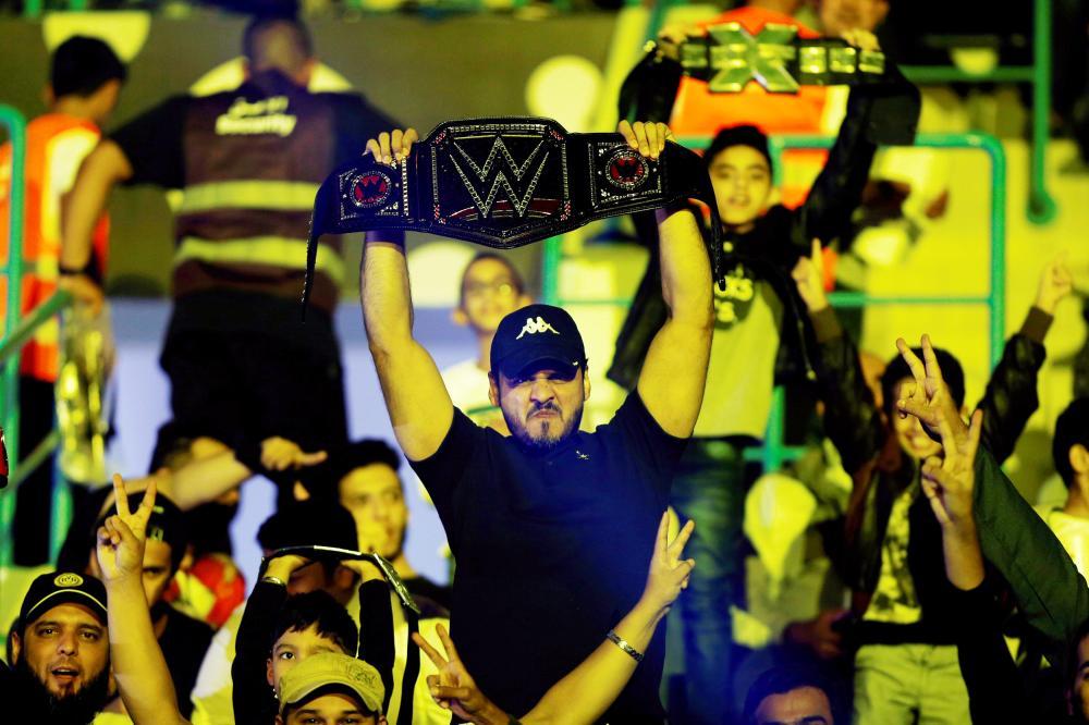Saudi fans watch the WWE Crown Jewel show at King Saud University Stadium in Riyadh Friday. — Reuters