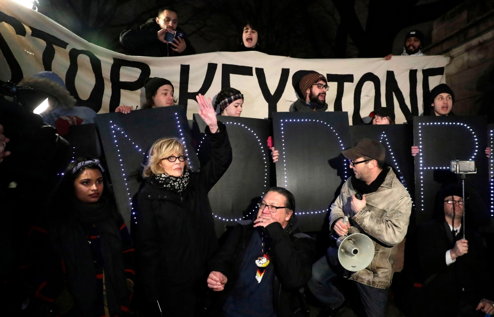 US actress and political activist Jane Fonda, second left, attends a rally with opponents of the Keystone XL and Dakota Access pipelines as they protest US President Donald Trump's executive orders advancing their construction at Columbus Circle in New York in Jan. 24, 2017. — AFP