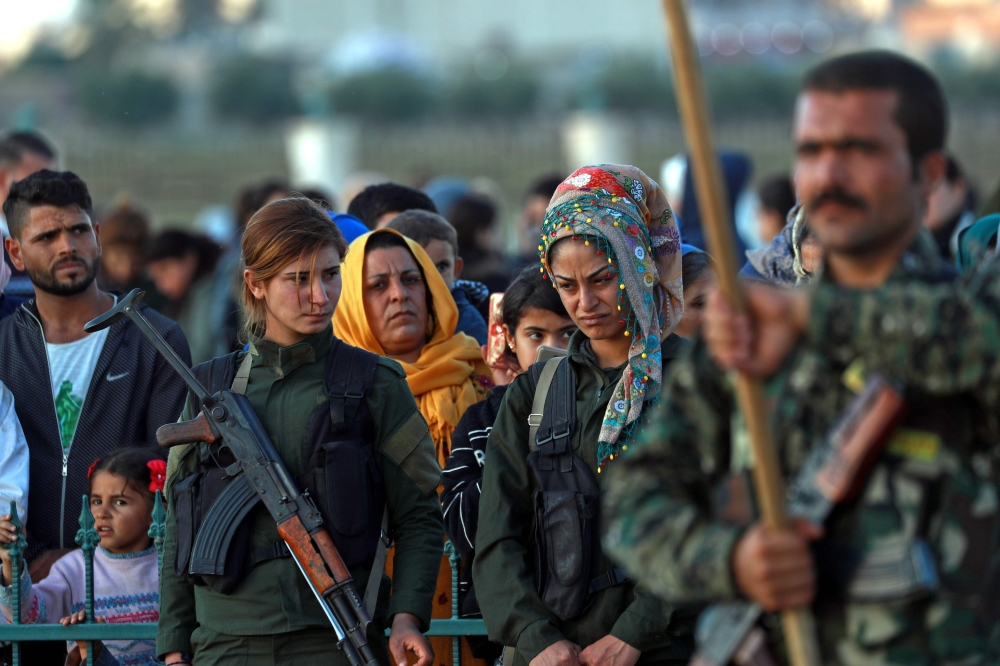 Syrian Democratic Forces (SDF) fighters attend the funeral of a fellow fighter, killed in an offensive by Daesh against an SDF position near Deir Ezzor, in the northern Syria Kurdish town of Kobane, in this Nov. 6, 2018 file photo.  — AFP