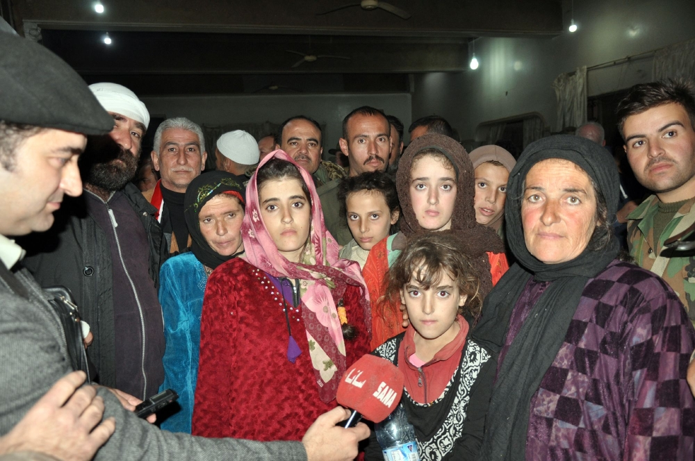 Druze women and children, abducted in July from Sweida by Daesh (the so-called IS), pose for a picture as they are being welcomed by relatives upon their arrival in their hometown in the southern Syrian province of Sweida on Thursday night.  — AFP