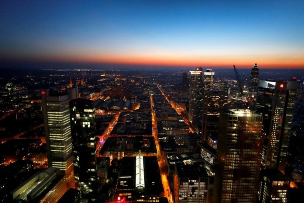 The sun sets behind the financial district early evening in Frankfurt, Germany, in this recent photo. — Reuters