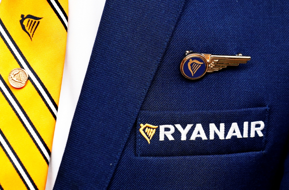 Ryanair logo is pictured on the the jacket of a cabin crew member ahead of a news conference by Ryanair union representatives in Brussels, Belgium in this file photo. — Reuters
