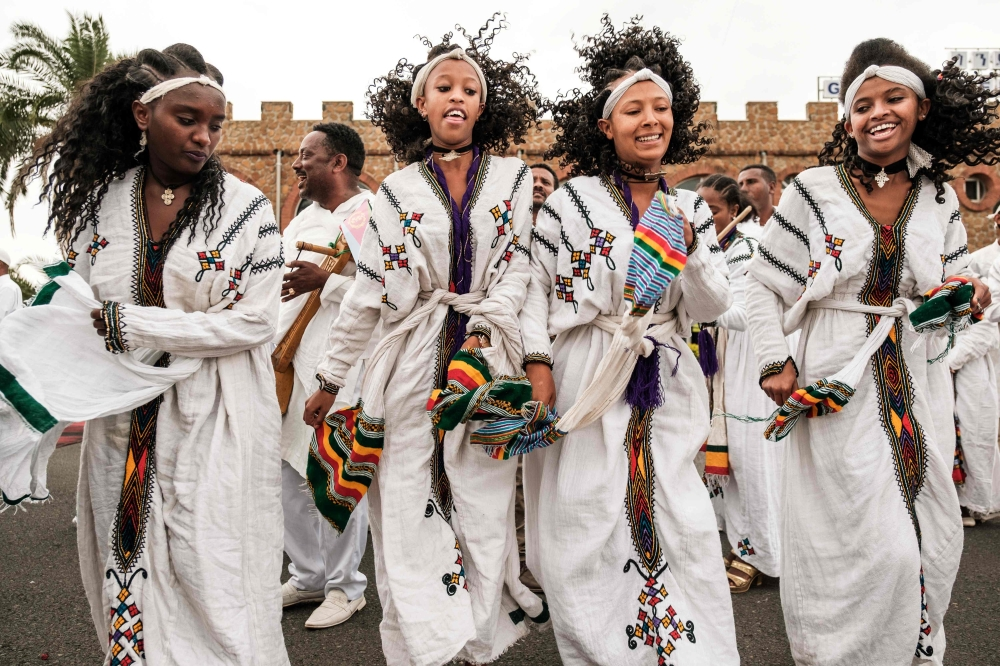 Women dance as they wait for the arrival of Eritrea's president at the airport in Gondar, northern Ethiopia, on Friday. — AFP