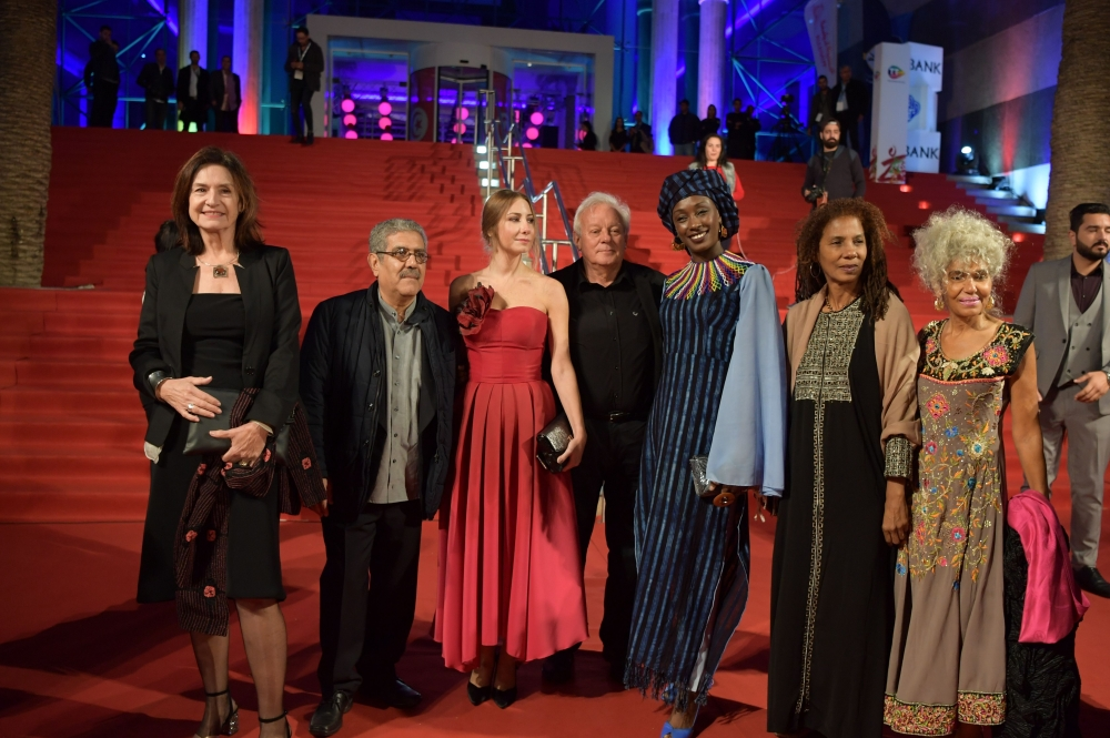 Carthage Film Festival's jury members and president Deborah Young (1st-L) arrive the closing ceremony of the 29th edition of the Carthage Film Festival in Tunis. — AFP