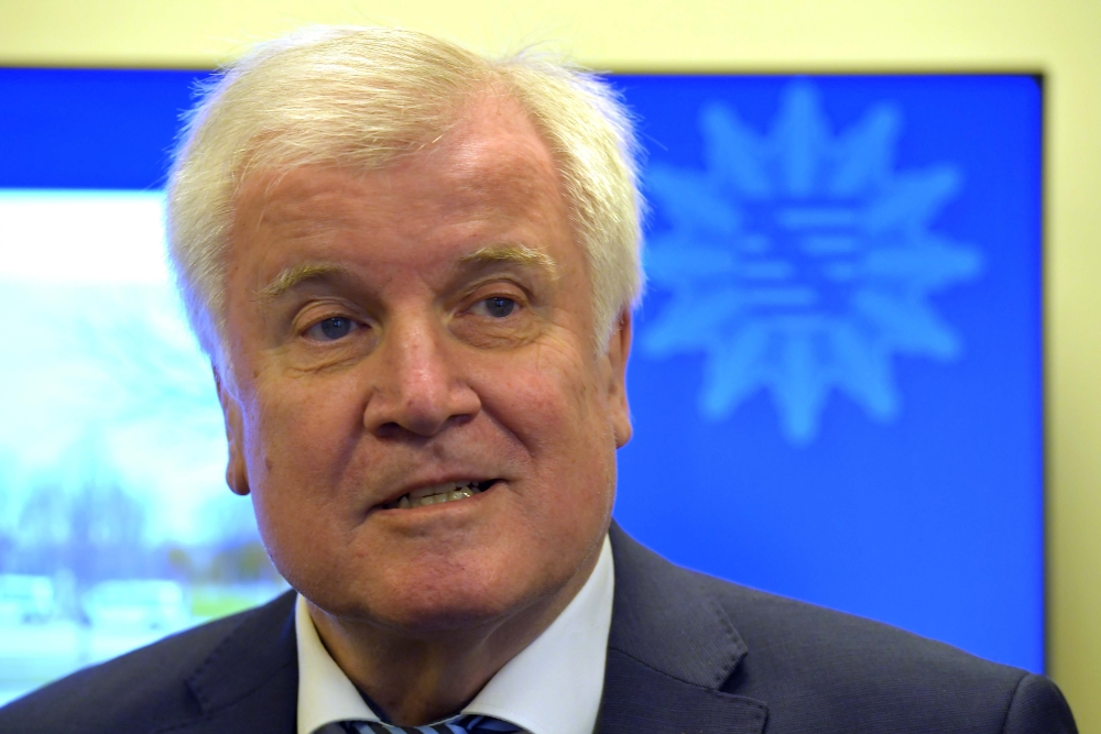 German Interior Minister Horst Seehofer visits tracing and competence center of the Federal Police department in Bautzen, Germany, on Monday. — Reuters