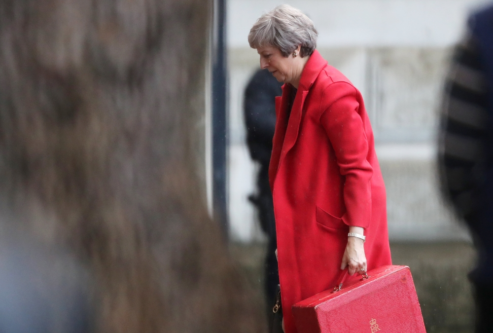 Britain's Prime Minister Theresa May returns to Downing Street in London on Monday. — Reuters