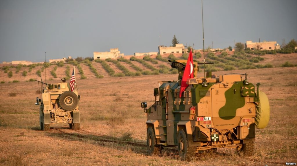 Turkish and US troops are pictured during a joint patrol in Manbij area, northern Syria, last week. — Reuters