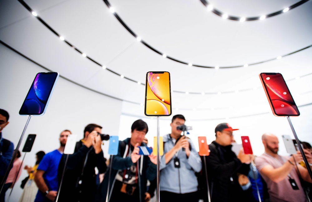 Apple iPhone Xr models rest on display during a launch event in Cupertino, California, in this Sept. 12, 2018 file photo. — AFP