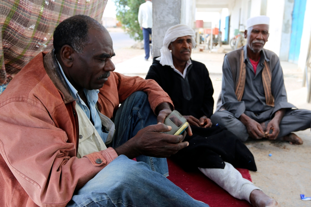 Tunisian men gather in Gosba, near the southeastern town of Medenine. Black Tunisians, including some descended from slaves, make up a minority that is barely visible in the north African country. Many hope for greater equality after a law was passed earlier this year criminalizing all forms of racism. — AFP