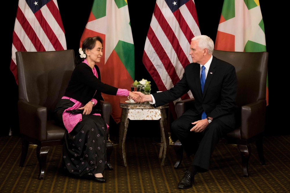 US Vice President Mike Pence, right, shakes hands with Myanmar State Counselor Aung San Suu Kyi during a bilateral meeting on the sidelines of the 33rd Association of Southeast Asian Nations (ASEAN) summit in Singapore on Wednesday. — AFP