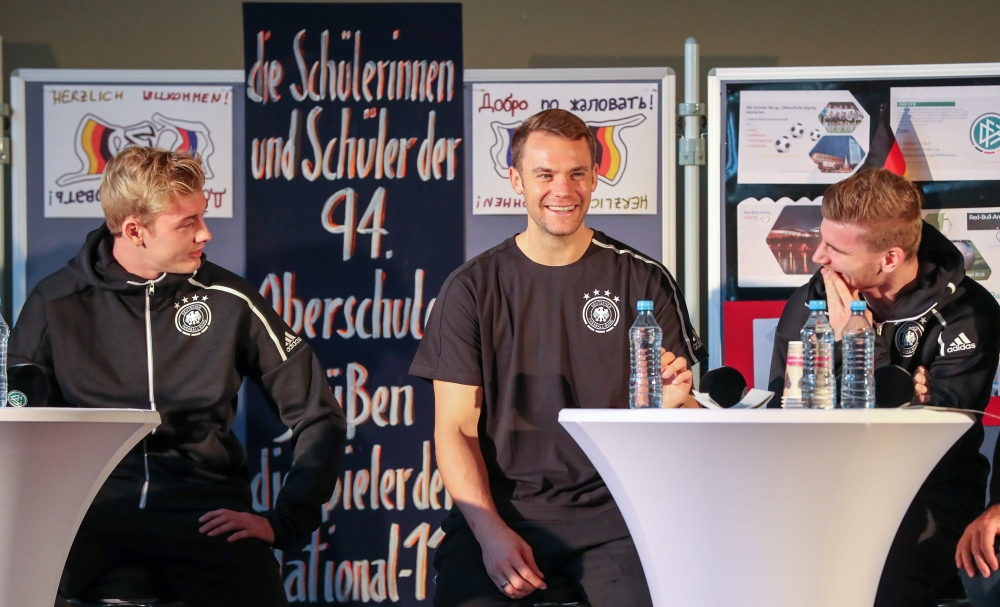 (L-R) Germany's forward Julian Brandt, Germany's goalkeeper Manuel Neuer and Germany's forward Timo Werner attend a question and answer session with students of the sport high school in Leipzig, eastern Germany on Tuesday, two days before an international friendly match Germany vs Russia. — AFP
