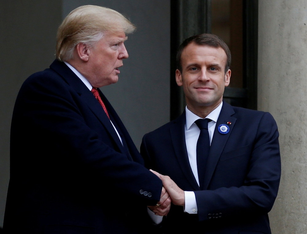 French President Emmanuel Macron shakes hands with US President Donald Trump after a meeting at the Elysee Palace on the eve of the commemoration ceremony for Armistice Day, 100 years after the end of the World War I, in Paris, France, in this Nov. 10, 2018 file photo. — Reuters
