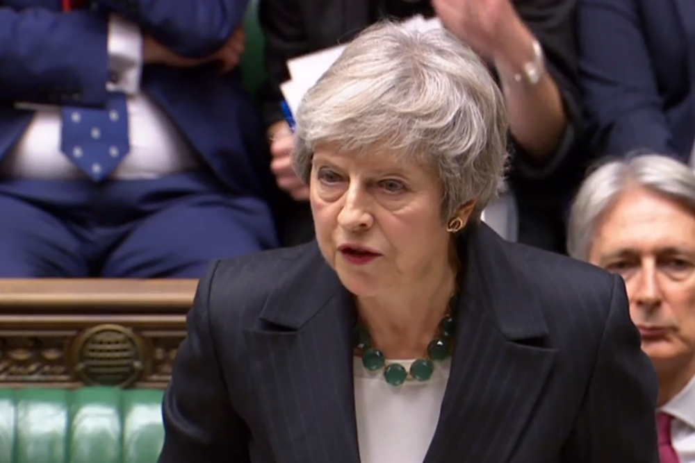 British Prime Minister Theresa May gives a statement to the House of Commons in London on Thursday, on the draft withdrawal agreement negotiated between the European Union and the United Kingdom. — AFP