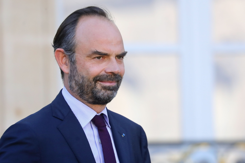 French Prime Minister Edouard Philippe leaves the Elysee presidential Palace after the weekly Cabinet meeting in Paris on Thursday. — AFP