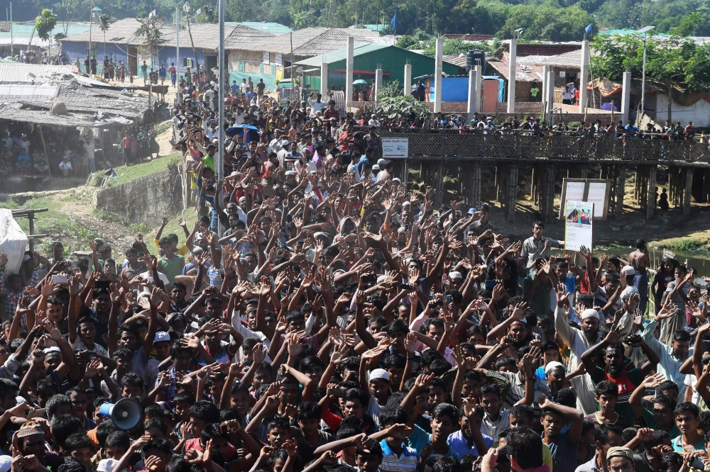 Rohingya refugees shout slogans at a protest against a disputed repatriation program at the Unchiprang refugee camp near Teknaf, Bangladesh, on Thursday. — AFP