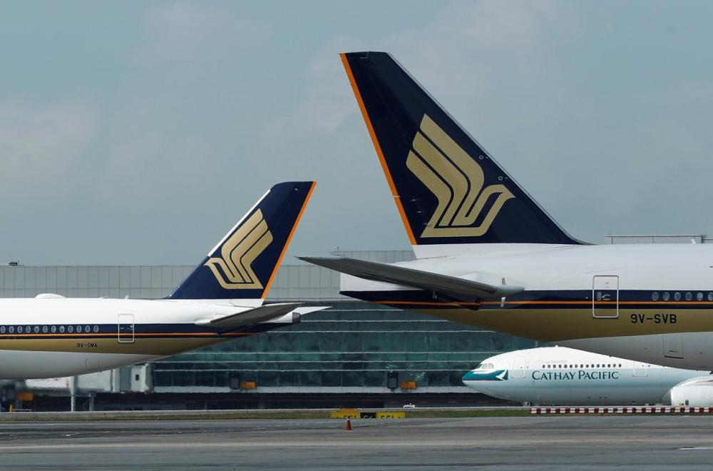 Singapore Airlines planes are pictured on the tarmac at Changi Airport in this file photo. — Reuters