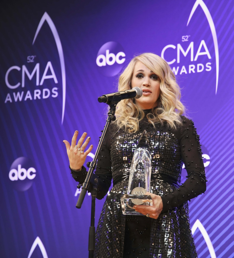 Female Vocalist of the Year Carrie Underwood holds her award at 52nd Country Music Association Awards in Nashville, Tennessee, on Wednesday. — Reuters