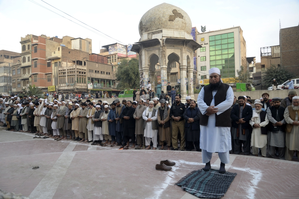 Pakistani Muslims offer absentia pray of superintendent of police (SP) Tahir Dawar who was found dead in Nangarhar provinces of Afghanistan, during a funeral in Peshawar, Pakistan, on Thursday. — AFP