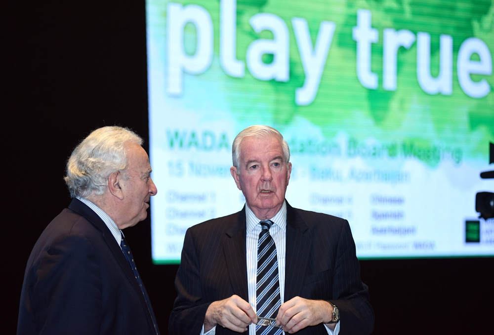 President of the World Anti-Doping Agency (WADA), Craig Reedie (R) attends a session of the WADA foundation board in Baku on Thursday. The organization has faced widespread criticism since a decision in September to lift a ban on the Russian Anti-Doping Agency (RUSADA) paved the way for Russian athletes to return to international competition. — AFP