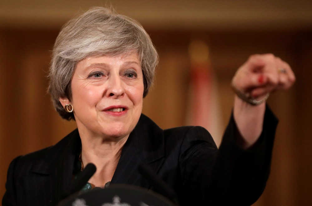 British Prime Minister Theresa May takes questions during a news conference at Downing Street in London, on Thursday. — Reuters