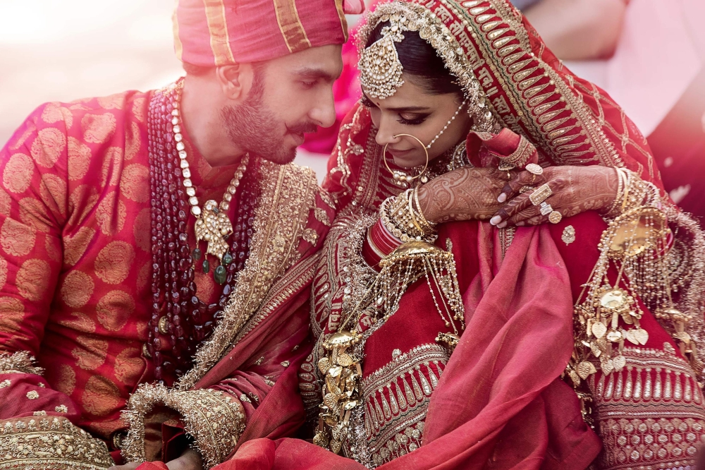 In this handout picture taken on Thursday and released by Yash Raj Films, Bollywood actors Deepika Padukone, right, and Ranveer Singh celebrate their wedding in Lake Como, in the northern Italy's Lombardy region. — AFP