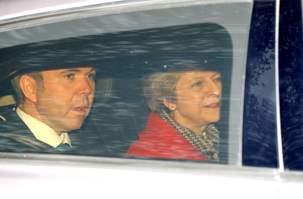 British Prime Minister Theresa May, together with her Chief of Staff Gavin Barwell, leaves the LBC radio studios in central London on Friday. — Reuters
