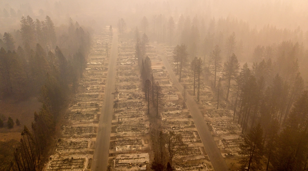 In this aerial photo, a burned neighborhood is seen in Paradise, California, on Thursday. — AFP