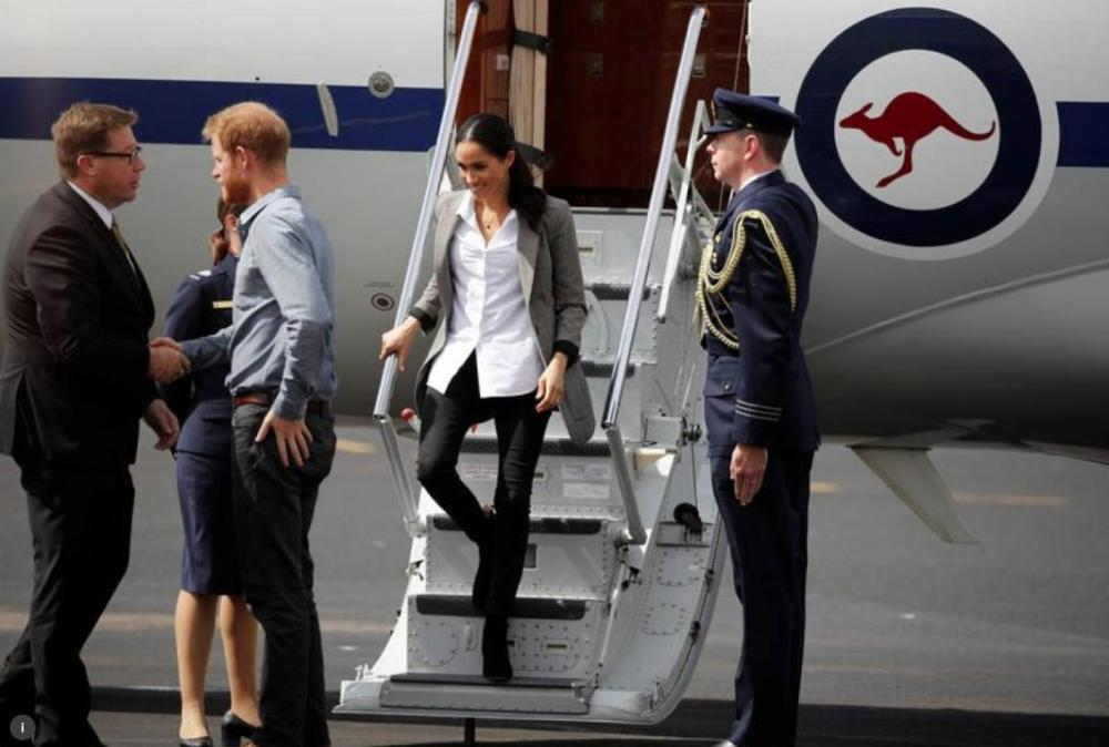 Britain's Prince Harry and his wife Meghan, Duchess of Sussex, arrive at Dubbo airport, Dubbo, Australia, in this file photo. — Reuters