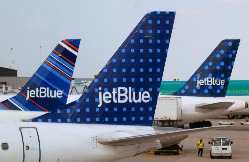 JetBlue Airways aircraft pictured at departure gates at John F Kennedy International Airport in New York in this file photo. — Reuters