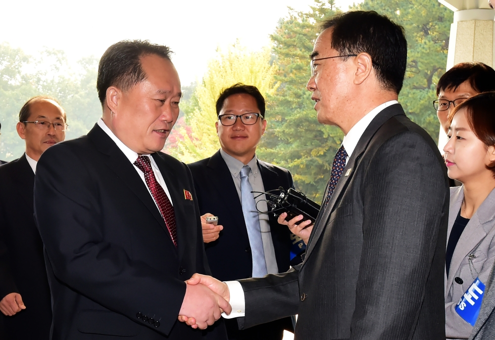 South Korean Unification Minister Cho Myoung-gyon, right, greets his North Korean counterpart Ri Son Gwon, left, before their meeting at the southern side of the border truce village of Panmunjom in the Demilitarized Zone (DMZ) dividing the two Koreas in this Oct. 14, 2018 file photo. — AFP
