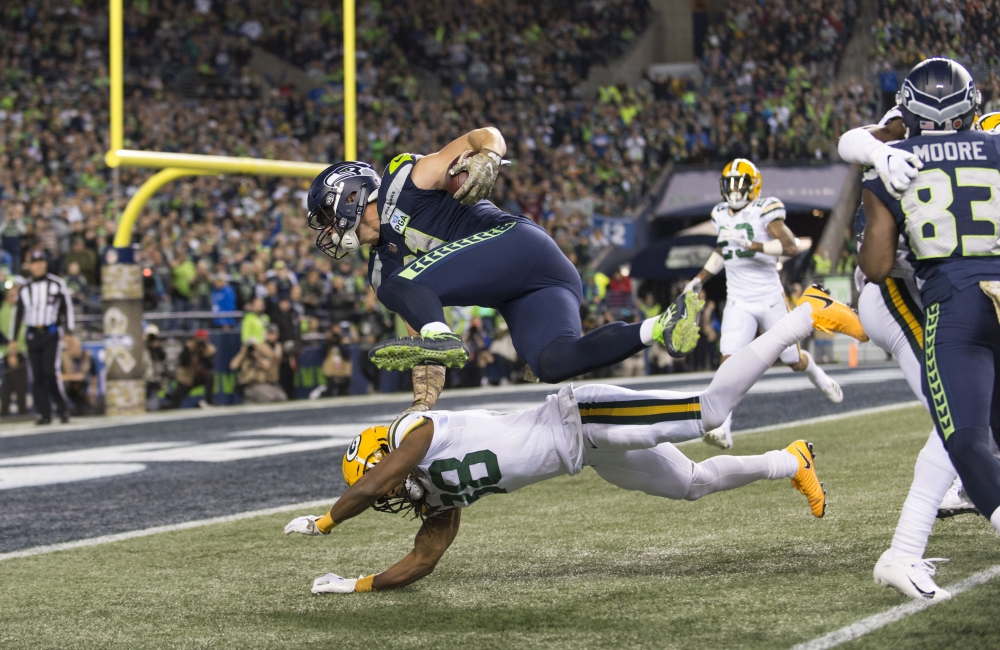 Seattle Seahawks tight end Nick Vannett (81) dives over Green Bay Packers cornerback Tramon Williams (38) during the first half at CenturyLink Field. — Reuters