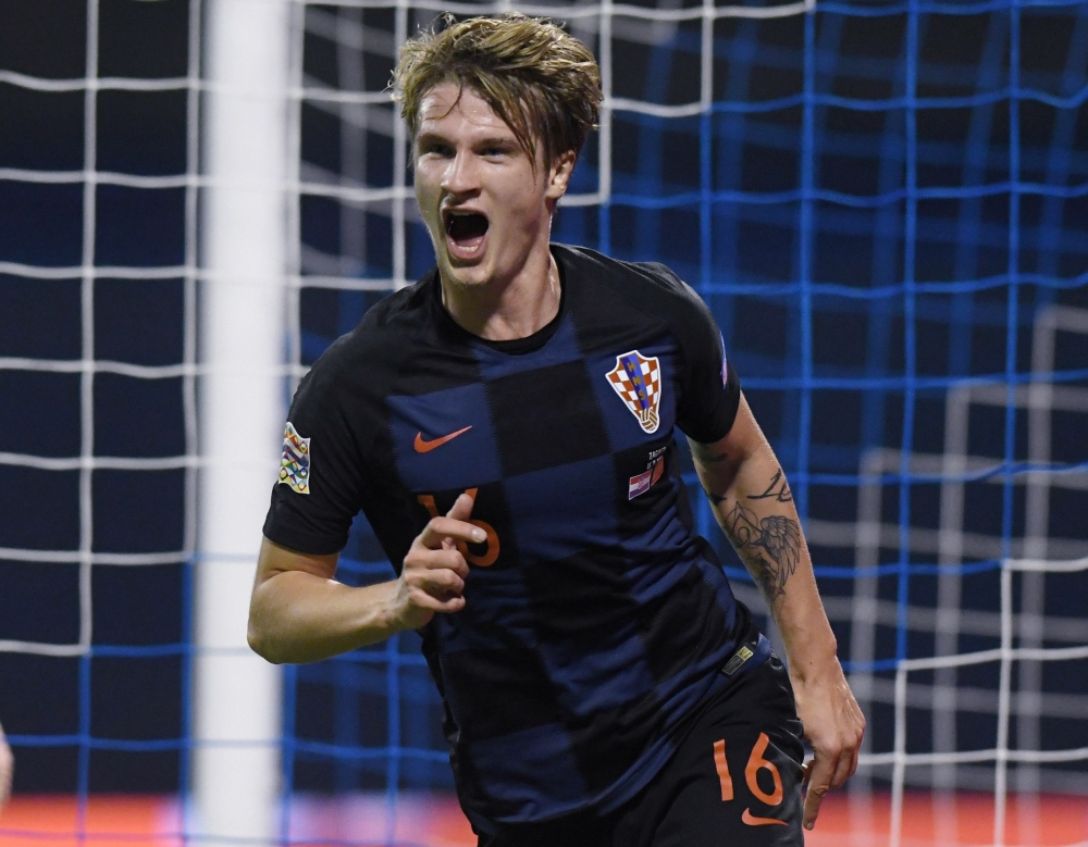 Croatia's Tin Jedvaj celebrates after scoring a goal during the UEFA Nations League football match between Croatia and Spain at the Maksimir Stadium in Zagreb on Thursday. — AFP