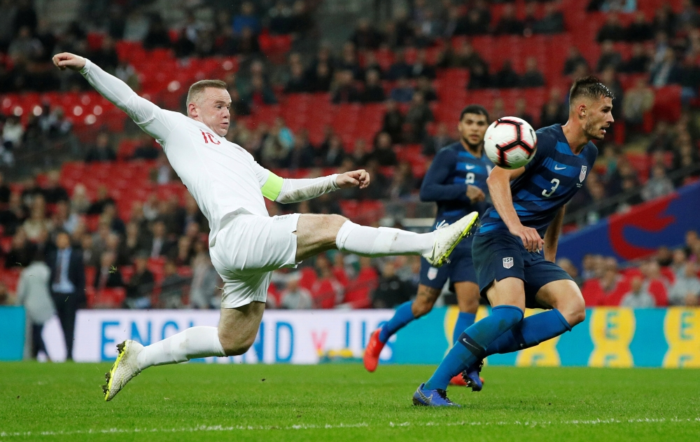 England's Wayne Rooney misses a chance to score during the International Friendly match against United States at the Wembley Stadium, London, Britain, on Thursday. — Reuters