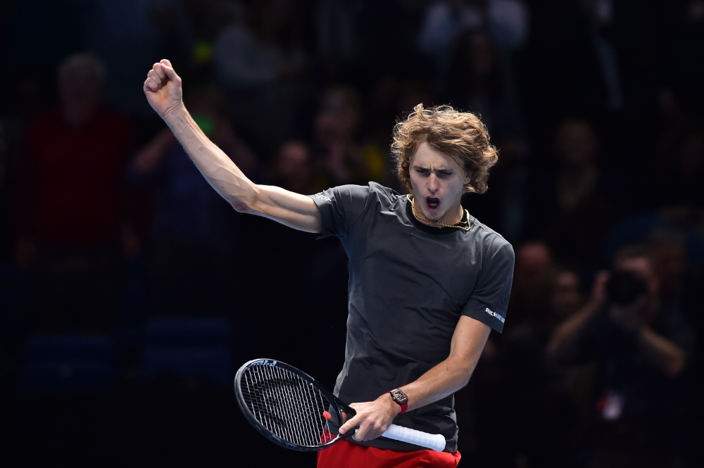 Germany's Alexander Zverev celebrates beating US player John Isner in their men's singles round-robin match on day six of the ATP World Tour Finals tennis tournament at the O2 Arena in London on Friday. — AFP