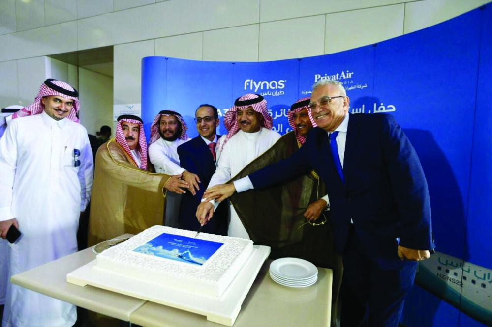 Abdul Hakim Al Tamimi, Chairman of the Civil Aviation Authority, and Ayed Al-Jeaid, Chairman of the Board of Directors of flynas, preside over the ceremony