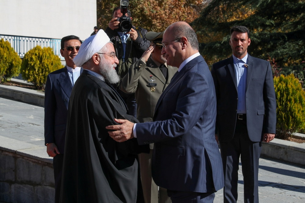 Iraq's President Barham Salih is welcomed by his Iranian counterpart Hassan Rohani during an official reception ceremony in Tehran, Saturday. — Reuters