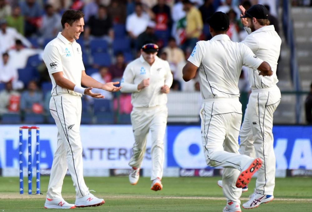 Left-arm pacer Trent Boult celebrates with his teammates after grabbing a wicket in the Pakistan innings with during the evenly-poised first Test in Abu Dhabi on Saturday.