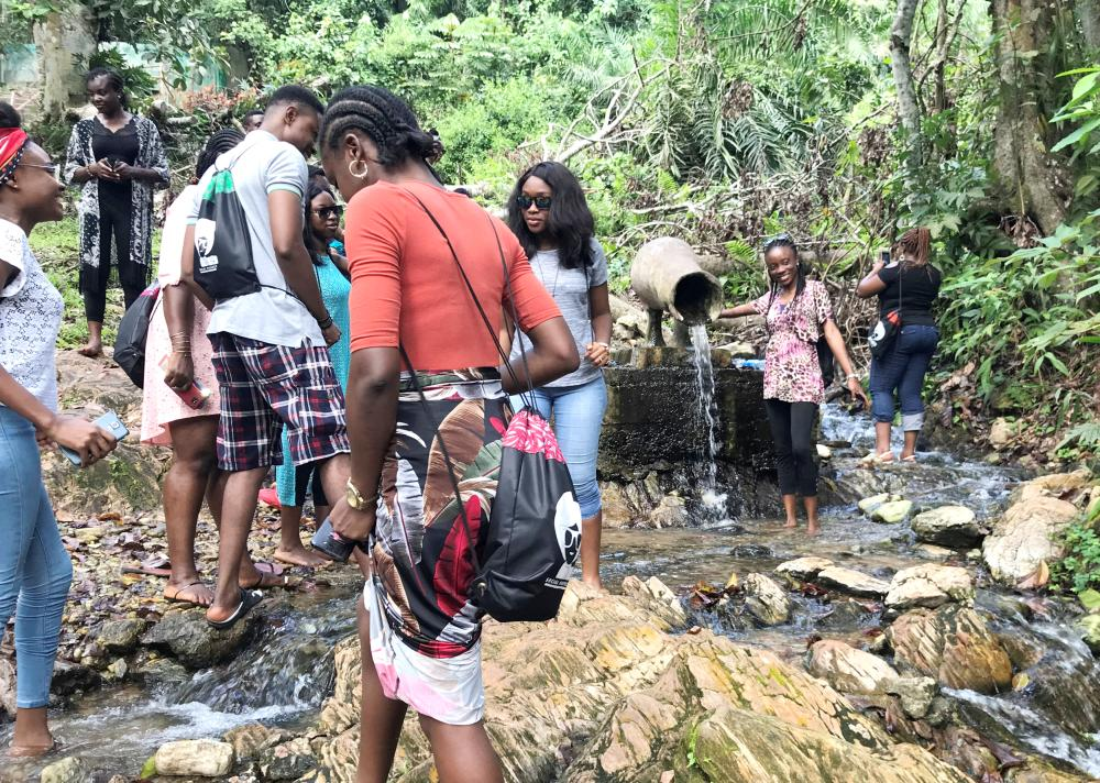 Tourists are seen walking through the warm spring at Ikogosi Warm Springs resort in Ekiti, Ekiti State, Nigeria. — Reuters