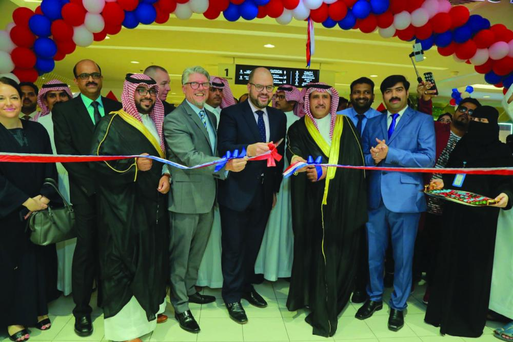 Ryan Gliha, American Consul General of the United States Consulate General in Jeddah, cuts the ceremonial ribbon during the inaugural