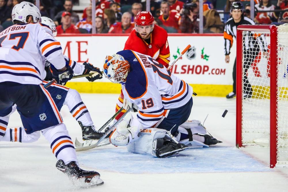 Calgary Flames center Elias Lindholm (28) scores a goal past Edmonton Oilers goaltender Mikko Koskinen (19) during the third period at Scotiabank Saddledome. — Reuters