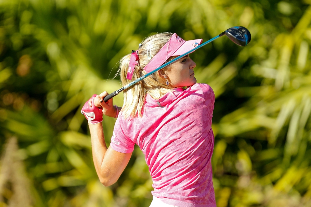 Lexi Thompson plays her shot from the 15th tee during the third round of the LPGA CME Group Tour Championship at Tiburon Golf Club on Saturday in Naples, Florida. — AFP