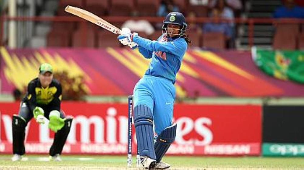 Smriti Mandhana hammered a 55-ball 82 to take India past Australia and to top of Group B in the Women's World Twenty20 in Guyana on Saturday.