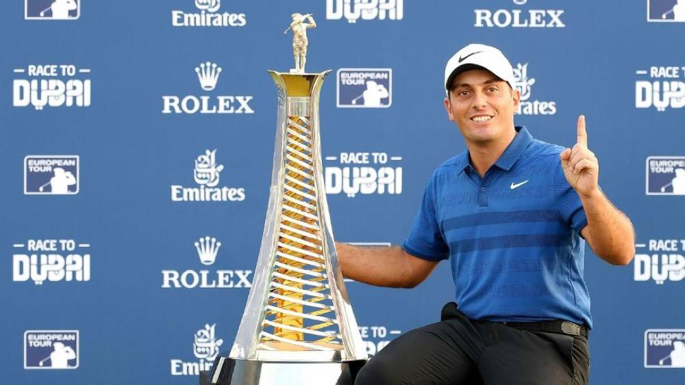 Francesco Molinari sits with the Race to Dubai trophy after the final round of the DP World Tour Championship at Jumeirah Golf Estates. — AFP