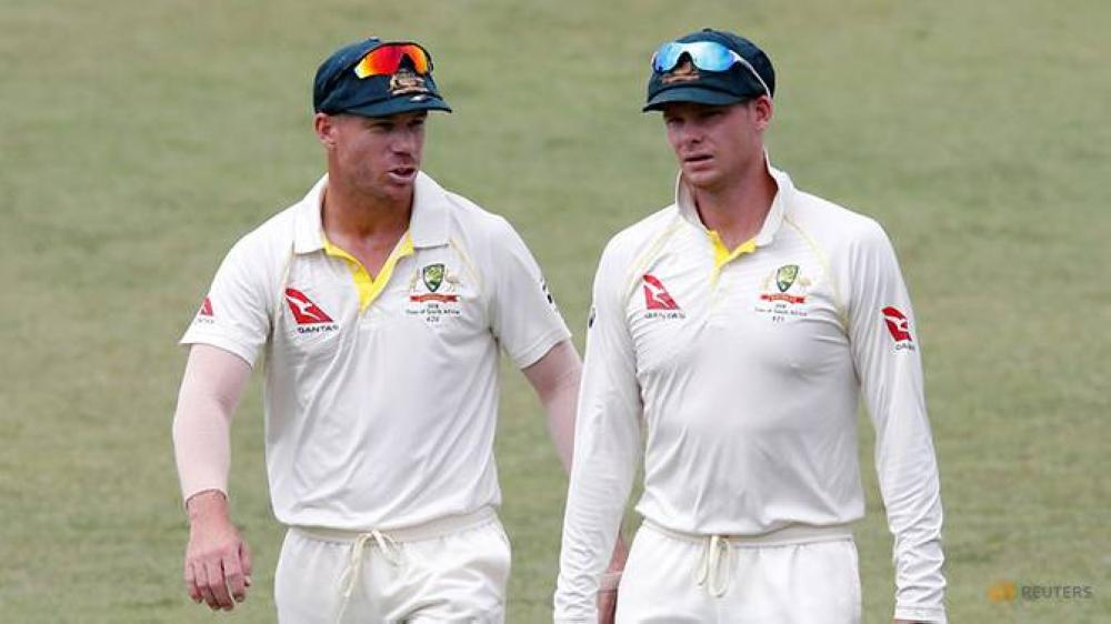 Australia's David Warner and Steve Smith leave the pitch after beating South Africa in the First Test match at the Kingsmead Stadium, Durban, South Africa, in this file photo. — Reuters