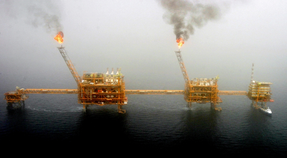 Gas flares from an oil production platform at the Soroush oilfields in the Arabian Gulf, south of the Iranian capital Tehran, in this July 25, 2005, file photo. — Reuters