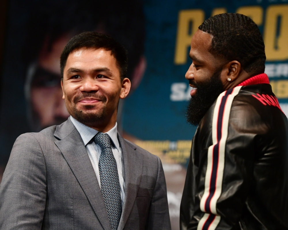 Manny Pacquiao (L) and Adrien Broner face off during a press conference on Monday in New York at Gotham Hall in preparation for their upcoming match, set to take place on Jan. 19, 2019 in Las Vegas. — AFP
