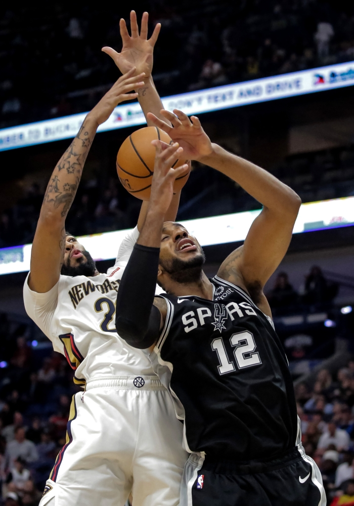 New Orleans Pelicans forward Anthony Davis (23) and San Antonio Spurs forward LaMarcus Aldridge (12) battle for a rebound during the second half at the Smoothie King Center. — Reuters