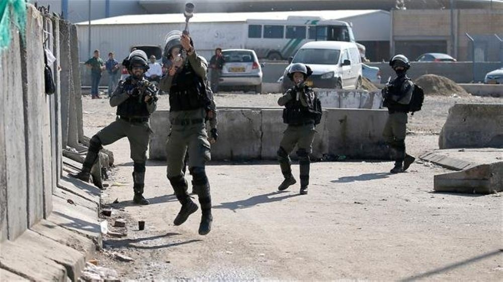 Israeli forces fire tear gas canisters as Palestinian and foreign journalists demonstrate to demand safety measures at the Qalandiya checkpoint, between Jerusalem Al-Quds and Ramallah, in the occupied West Bank. — AFP